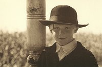Amish Boy Leaning on Post