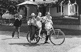 Five Mennonite Children on Bicycle
